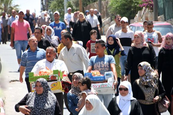 19.06.15. Bethlehem. Checkpoint 300  Muslims on their way to Friday prayers at Al-Aqsa Mosque during the first Friday of Ramadan. Photo EAPPI / I. Tanner