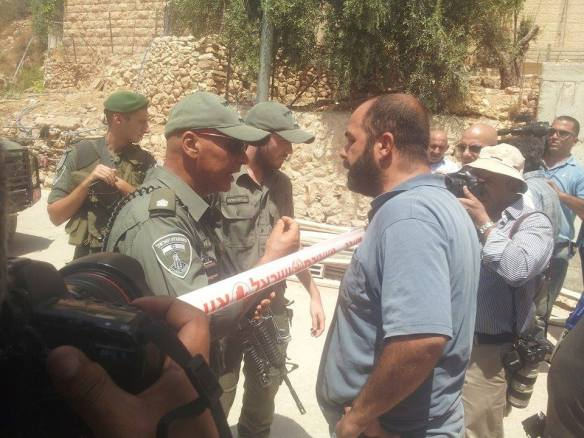 17.08.15 Beit Jala. Wadi Ahmad, Palestinian land owner prevented from entering his olive groves by Israeli officer Photo EAPPI / Kozlak