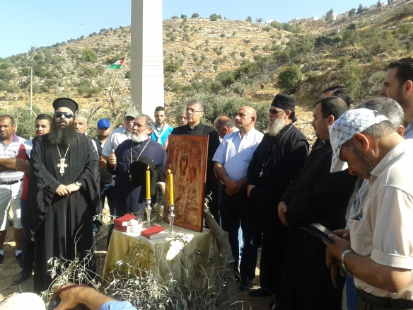 18.08.2015. Bethlehem. Bir Ouna. speach of the priest on the land of uprooted olive trees. Photo EAPPI / K. Kozlak