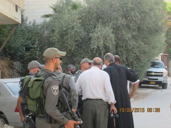 19.08.2015 priest negotiate with soldiers Beit Ouna EAPPI EOD
