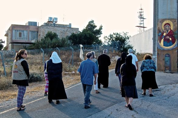 5_6_2015 CP300 Bethlehem Wall Prayer with icon and Clemence hoouse Photo H Jonsson EAPPI