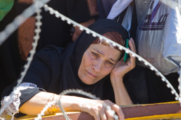 06.07.00 Qalandia checkpoint, Palestinian woman held in queue at checkpoint on her way to Jerusalem. Photo EAPPI / J. Griffin