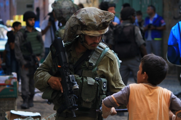 05.09.15. Hebron, Old City. Palestinian boy is stopped by soldier during Settlers Tour. Photo EAPPI /R. Leme