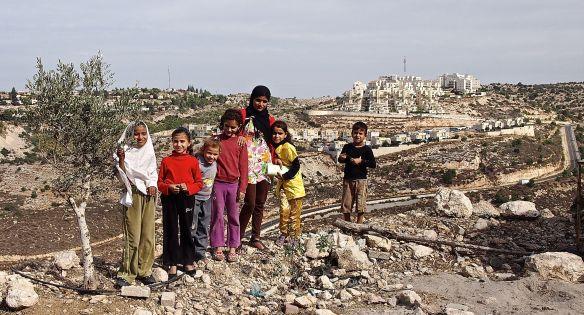 23.11.13. Tulkaram, Children living on the hill of the Ras at Tira village with settlement Alfe Menashe in the background. Photo EAPPI /Elina