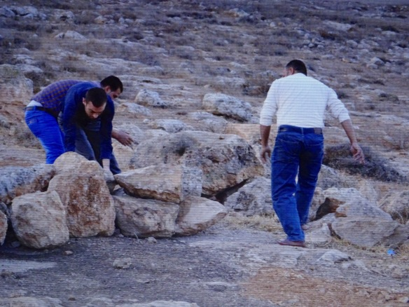 13-10-15 South Hebron Hills, Jinba. teachers removing road block at entrance of access dirt road. Photo EAPPI