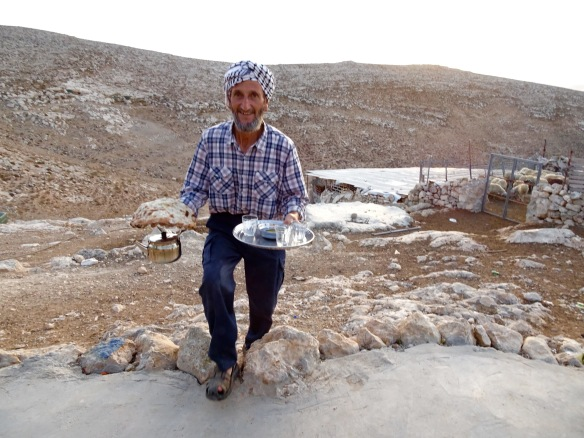 13-10-15 South Hebron Hills, Bir al'Idd- Ziad bringing the morning tea. Photo EAPPI/ J. Toureille.