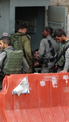 Palestinian child being detained by Israeli soldiers at CheckPoint 56. Photo EAPPI/H. Griffiths 07.10.15