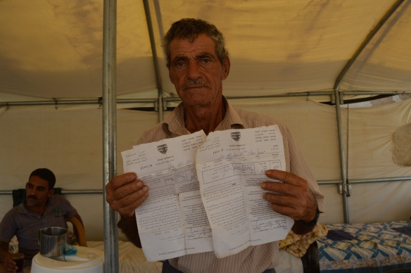 12.10.15. Jordan Valley, Humsa. Mahmod with the orders given to him. EAPPI / J. Puukki