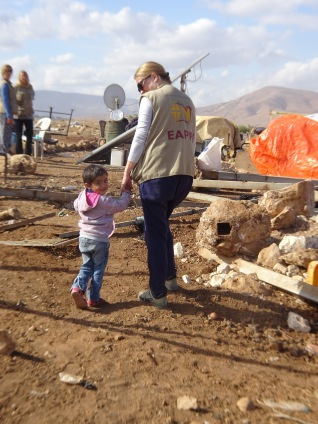 30.11.15, Jordan Valley, Al Hadidiya, EA with child after house demolition, Photo EAPPI/J. Fleischli