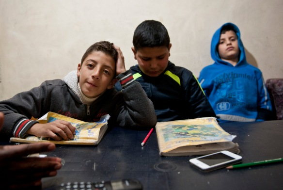 Bethlehem. Deheisha Camp, Students Bashir, Malik and Ramiz learn English with their teacher Fatima in the camp. Photo EAPPI/ P.Morgan