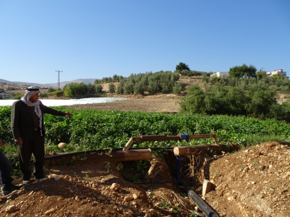 (PHOTO B) 09.12.15. Baddala, Jordan Valley, Palestine. Abdullah Sawafta shows the altered fresh water pipework. Photo EAPPI/P Longden