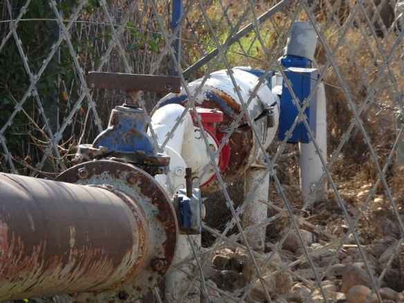 (PHOTO G) 09.12.15. Baddala, Jordan Valley, Palestine. Fresh water supply pipes with Israeli security fence. Photo EAPPI/P Longden