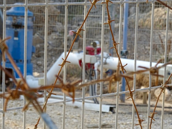 (PHOTO H) 23.12.15. North Jordan Valley, Palestine. Israeli Mekorot company water supply with protective fence and barbed wire. Photo EAPPI/K. Ellinggard