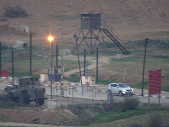 03.02.16. Jordan Valley, Hamra checkpoint, View of Hamra checkpoint showing sentry tower and vehicle passing through. Photo EAPPI. P. Longden