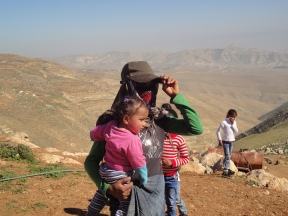 05.02.16, Bedouin woman and children, watches soldiers demolishing her tent. Photo EAPPI: M Mowe