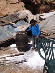 05.02.16. Child helps to salvage belongings from the rubble after the demolitions. Photo EAPPI/M. Mowe