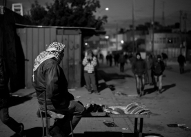 06.01.16. CP300. Bread-seller outside the checkpoint as men arrive from villages around Hebron. Photo EAPPI/P. Morgan