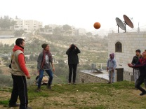 08.01.16. Hebron. EAs playing volleyball with children in Wadi al Hussein valley. EAPPI/E. Röst