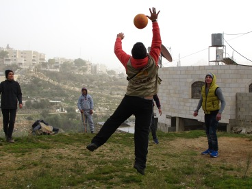 08.01.16. Hebron. EAs playing volleyball with children in Wadi al Hussein valley2. EAPPI/E. Röst
