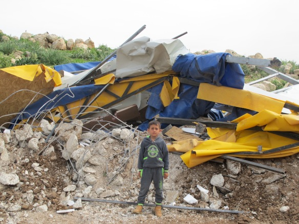 02.03.16, Nablus, Khirbet Tana. A kid in front of his demolished school. Photo EAPPI/M. Stöpfer