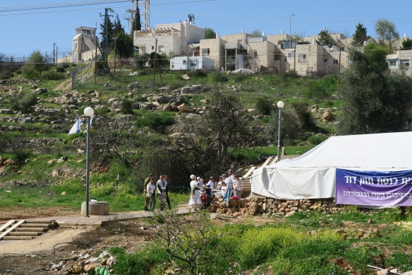 05.03.16, Hebron. Synagogue tent and settlers, Givat Ha'avot in the background. EAPPI:A. Kaiser