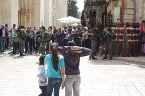 16. Crowd control at the entrance to The Church of the Holy Sepulchre – the site of the last four stations of the Via Dolorosa, believed to be the site of Jesus' crucifixion and tomb. Photo EAPPI/ K. Ramberg Aasen.