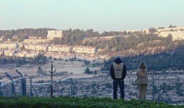 10.12.15 Bethlehem, Cremisan Valley. EAs look across the valley towards construction work at Gilo settlement. Photo EAPPI - M. Peres