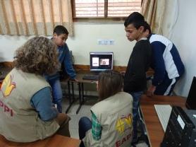 School children show EAs their documentation of soldiers attacks on their school. Al Khader., Bethlehem, Photo EAPPI/T. Arne. 02.04.16