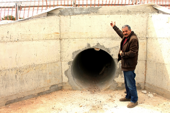 10.3.16, Abu Abdullah shows EAs the new access for residents of Deir Istiya under the main road. EAPPI A.Dunne_