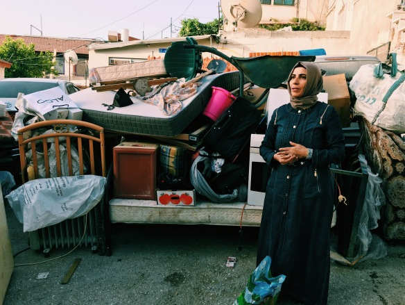 17.05.16 Wadi Joz. Karama Ghanem in front of her belongings. Photo EAPPI/ J. Svanelind