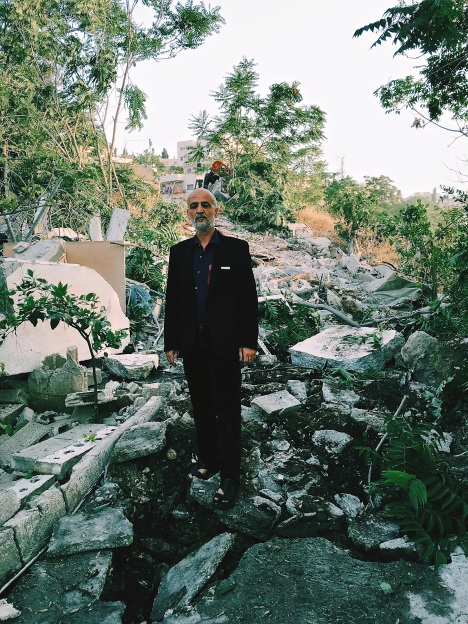 18.05.16 Wadi Joz. Areef Tootanji in front of remains of his house. Photo EAPPI/ J. Svanelind