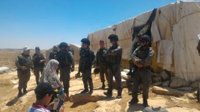 19.06.16 Israeli soldiers surround homes prior to demolitions. Photo. N. Nawaja