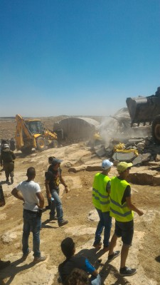 19.06.16 Contractors accompanied by Israeli military demolish homes. Photo. N. Nawaja