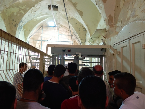 13.05.16-Hebron-H2-Men Wait to pass Checkpoint to Ibrahimi Mosque. Photo EAPPI/Emily