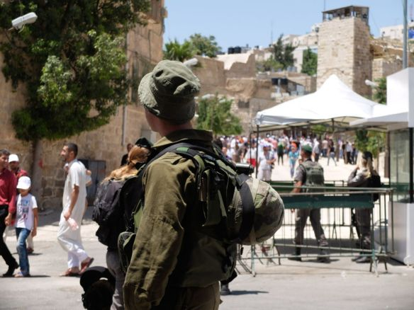 24.6.2016.Hebron-Soldier At Checkpoint near Mosque-Photo. EAPPI/E. Richardson