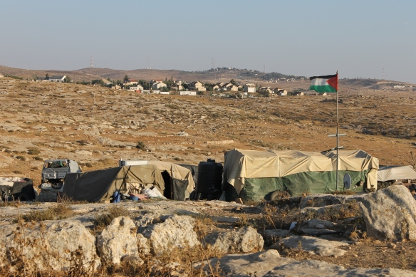 Susiya village with settlement in the background. Photo EAPPI/ L.l. Pianezza 28.6.2015 -