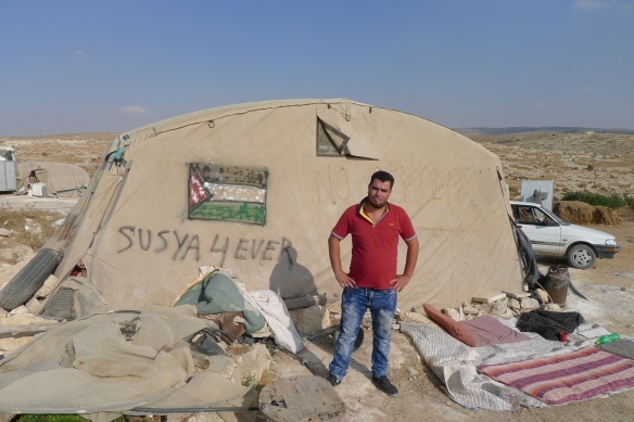 Susiya augist 2016 Nasser spokesman of Susiya in front of a tent in susiya1 photo EAPPISHH