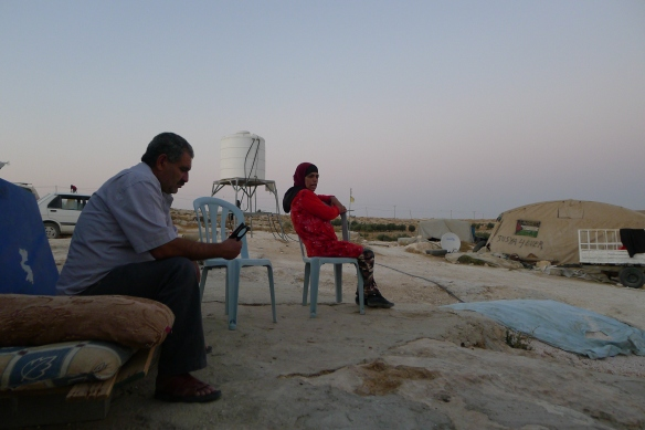 Susiya august 2016 Jihad, head of the village and his sister sitting in front of family tent - photo EAPPISHH