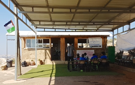 29.09.16, Arab ar Ramadin al Janubi, the primary school made of mud and hay does not have enough class rooms for all the classes so the youngest children have to sit outside. EAPPI-L. Jensen.jpg