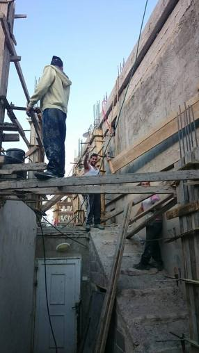 02-11-2016 Ad-Duheisha Camp, Bethlehem. Construction workers repair houses in the camp. People living here complain about the lack of space, since the camp cannot expand more. EAPPI Elina.jpg