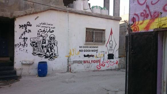 08-11-2016 Ad-Duheisha Camp, Bethlehem. Inside the camp, the walls tell us stories. The graffiti in the left shows Handala's family, a well known Palestinian character. EAPPI Elina.jpg